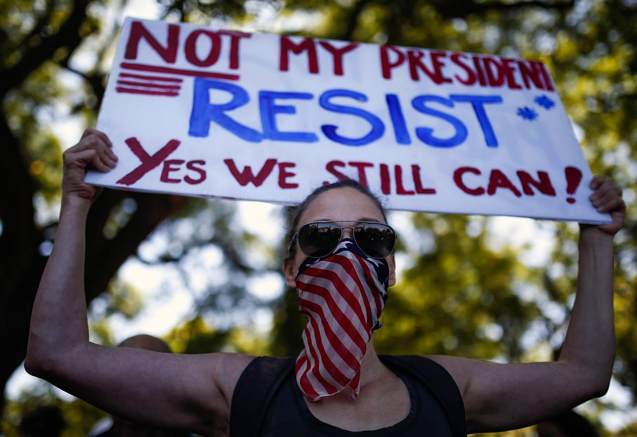 <p>A woman holds a sign during the women's march rally in Buenos Aires, Argentina, Saturday, Jan. 21, 2017. The march was held in solidarity with the Women's March on Washington, advocating women's rights and opposing Donald Trump's presidency. (AP Photo/Agustin Marcarian) </p>