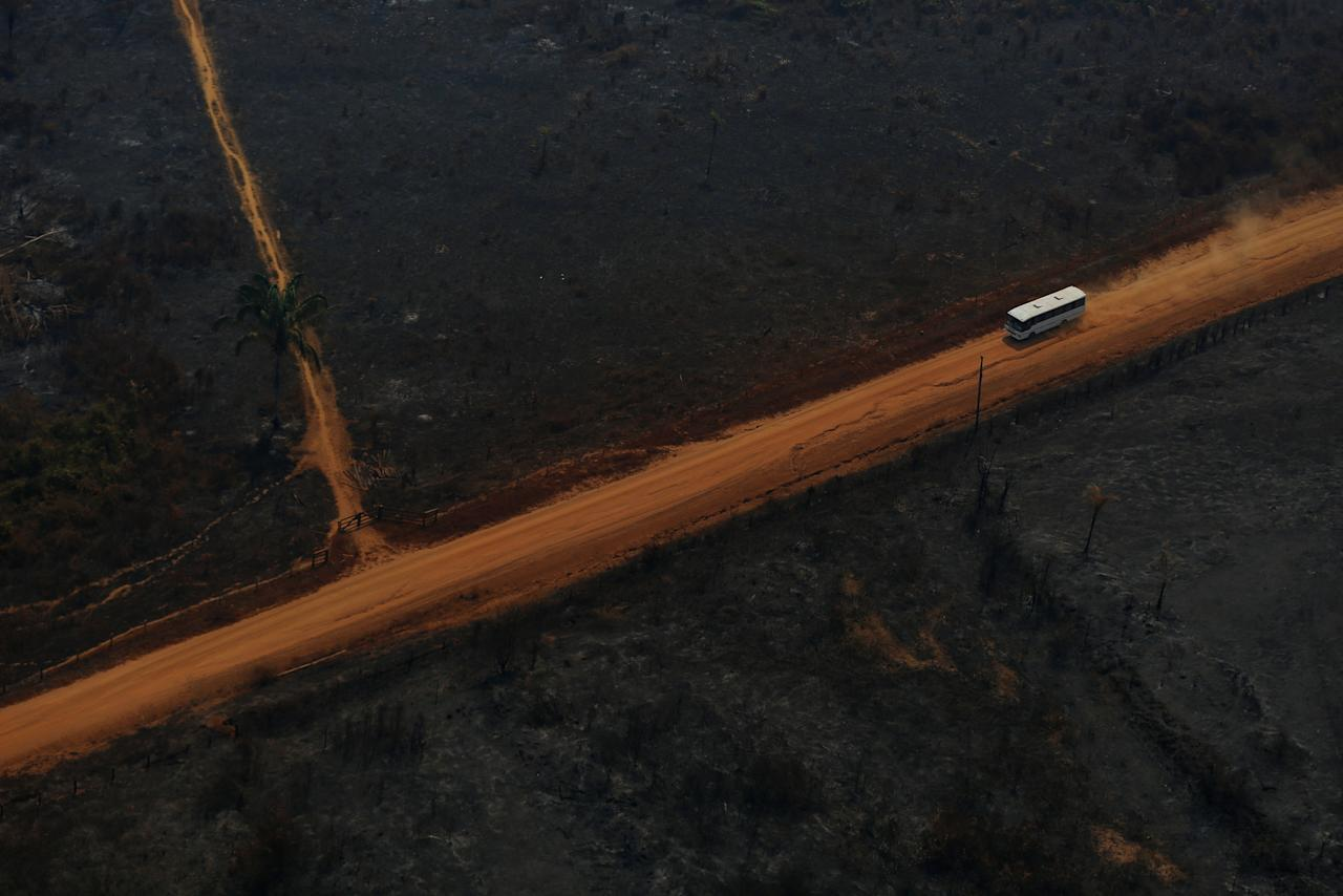 """A coach drives along the Transamazon Highway as it passes through deforested and burnt land during """"Operation Green Wave"""" conducted by agents of the Brazilian Institute for the Environment and Renewable Natural Resources, or Ibama, to combat illegal logging in Apui, in the southern region of the state of Amazonas, Brazil, August 4, 2017. REUTERS/Bruno Kelly         SEARCH """"DEFORESTATION"""" FOR THIS STORY. SEARCH """"WIDER IMAGE"""" FOR ALL STORIES.     TPX IMAGES OF THE DAY"""