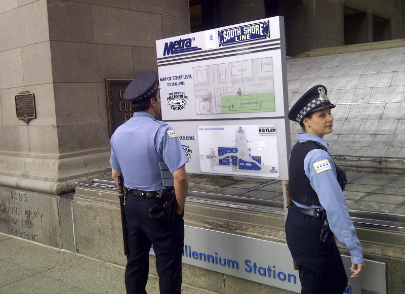 A pair of Chicago police officers stand outside the Metra commuter line's Millennium Station near Chicago's Grant Park Monday morning, May 21, 2012. Commuter traffic appears to be down in Chicago as the NATO summit enters its second and final day. Many companies heeded official advice and are let their workers stay home for the day. (AP Photo/Ryan J. Foley)