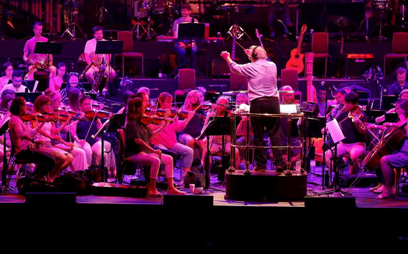 Nicholas Dodd conducts the Albert's Orchestra during a dress rehearsal of the 150th Anniversary Concert: David Arnold's 'A circle of sound', at the Royal Albert Hall