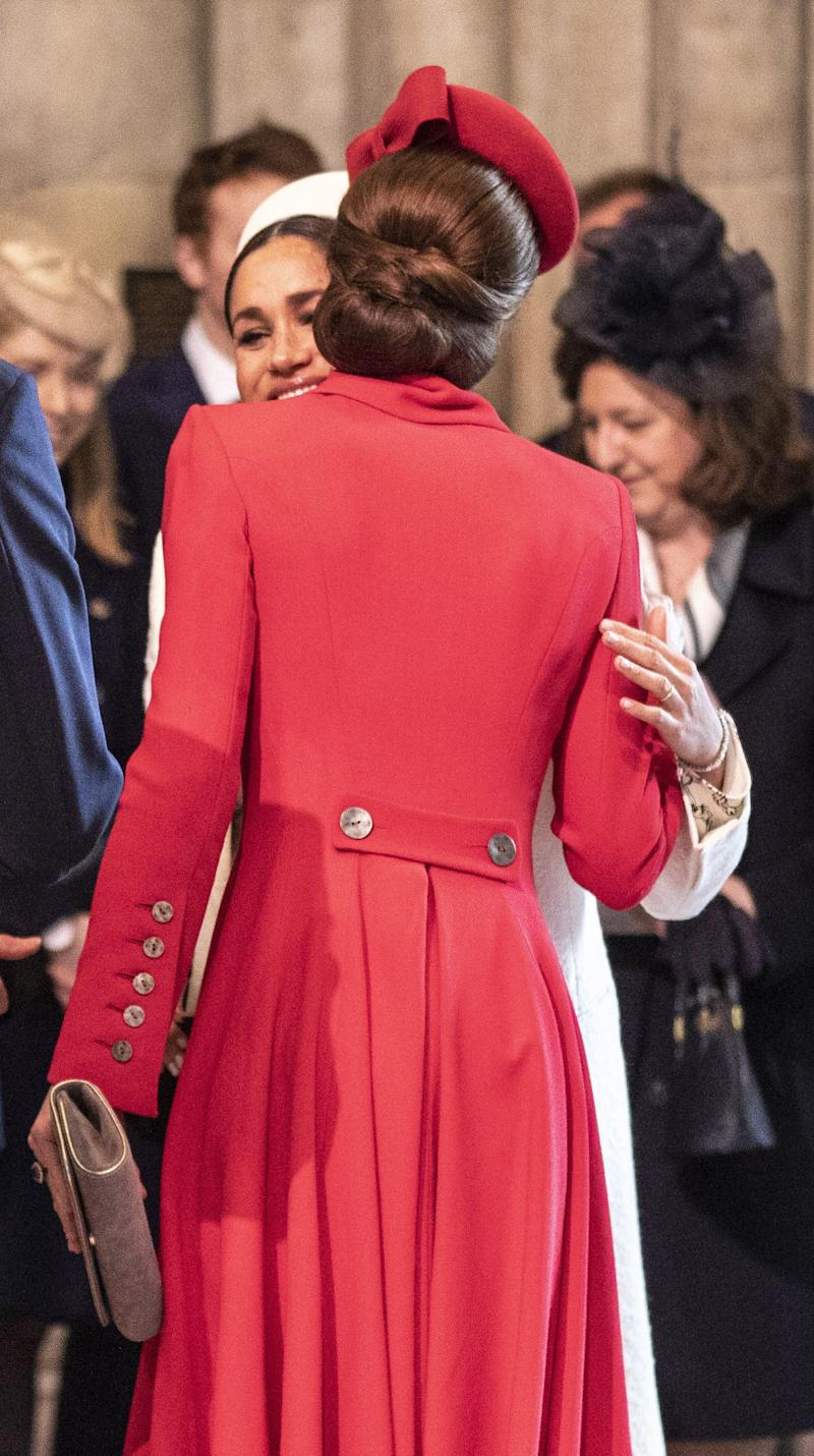Duchess Kate of Cambridge greets Duchess Meghan of Sussex at Westminster Abbey for a Commonwealth day service on March 11, 2019 in London.