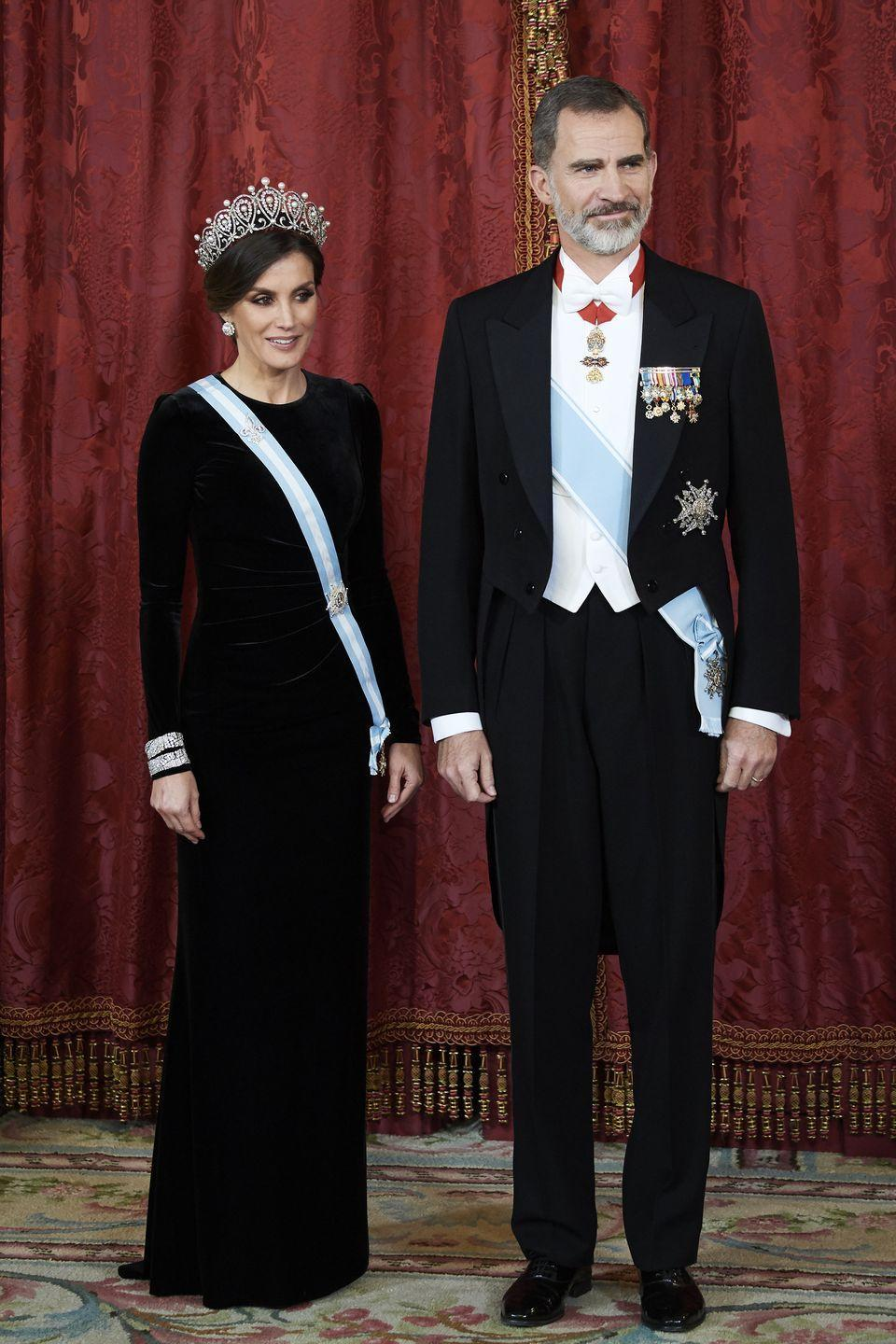 <p>In one of her most formal looks, Letizia wore a striking black, long-sleeved gown, a powder blue sash, and the jaw-dropping Cartier Loop Tiara. The event, held at the Madrid Royal Palace, was a Royal Gala Dinner in honor of Chinese president Xi Jinping and wife Peng Liyuan. </p>