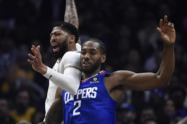 """The Lakers' Anthony Davis and Clippers' Kawhi Leonard battle March 8. The teams will resume their seasons against each other July 30 in Florida. <span class=""""copyright"""">(Mark J. Terrill / Associated Press)</span>"""