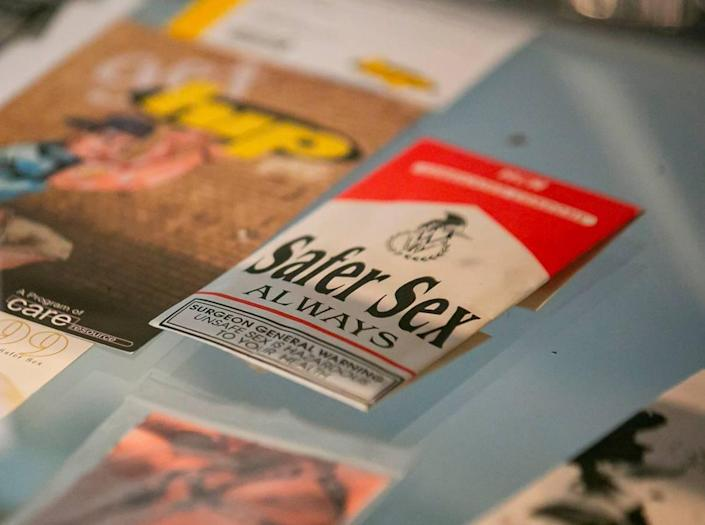 Various condom packages with messages are on display as part of the exhibit, A Matter of Time: Examining Forty Years of AIDS While Living through a Pandemic, at the Coral Gables Museum in Miami, Florida on Monday, April 5, 2021.