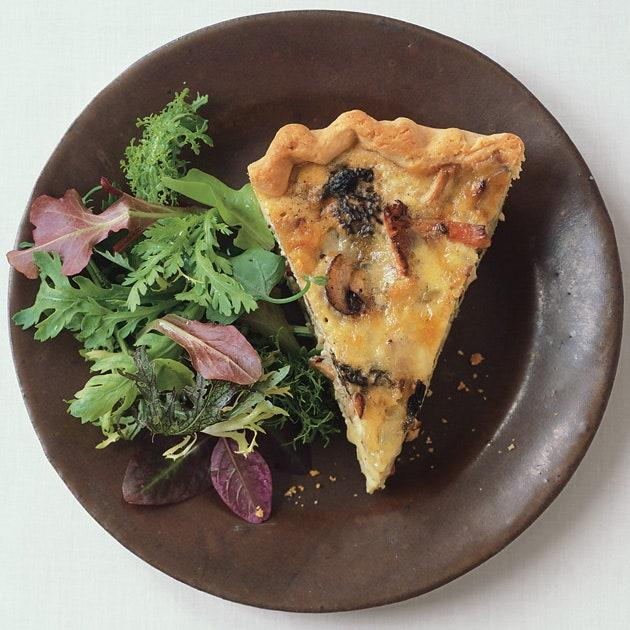 """This cheesy mushroom quiche makes a great meal anytime. Serve with smoked salmon and fruit for <a href=""""https://www.epicurious.com/recipes-menus/best-brunch-recipes-relaxing-weekend-breakfast-gallery?mbid=synd_yahoo_rss"""" rel=""""nofollow noopener"""" target=""""_blank"""" data-ylk=""""slk:brunch"""" class=""""link rapid-noclick-resp"""">brunch</a>, or with a salad for supper. <a href=""""https://www.epicurious.com/recipes/food/views/mushroom-and-fontina-quiche-355191?mbid=synd_yahoo_rss"""" rel=""""nofollow noopener"""" target=""""_blank"""" data-ylk=""""slk:See recipe."""" class=""""link rapid-noclick-resp"""">See recipe.</a>"""