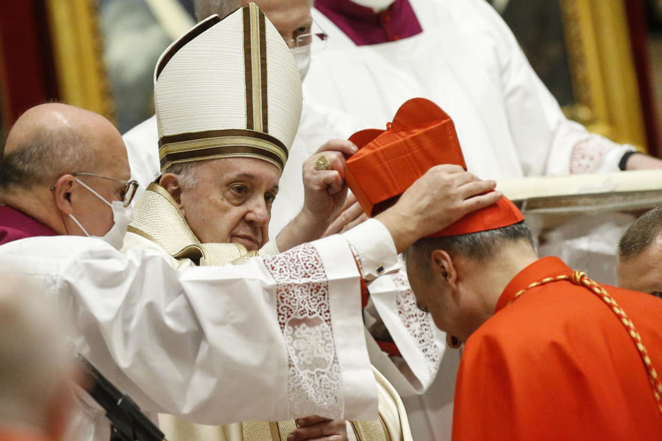 Italian newly Cardinal Marcello Semeraro receives his biretta as he is appointed cardinal by Pope Francis, during a consistory ceremony where 13 bishops were elevated to a cardinal's rank in St. Peter's Basilica at the Vatican, Saturday, Nov. 28, 2020. (Fabio Frustaci/POOL via AP)