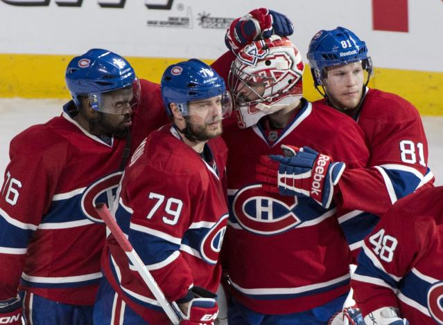 Montreal Canadiens' P.K. Subban, from left, Andrei Markov, Carey Price and Lars Eller, celebrate their victory over the Boston Bruins in an NHL playoff hockey game on Monday, May 12, 2014, in Montreal. (AP Photo/The Canadian Press, Paul Chiasson)