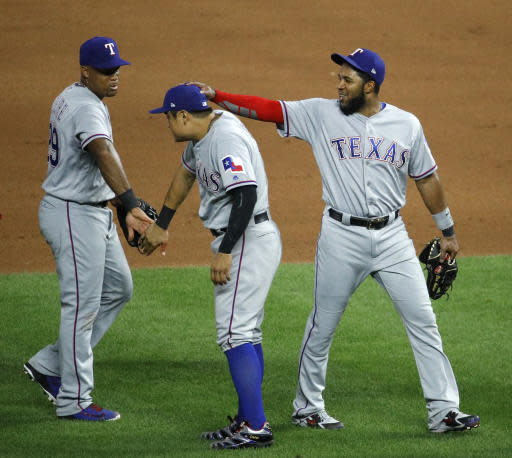 Texas Rangers' Adrian Beltre, left, Shin-Soo Choo, center and Elvis Andrus celebrate after their baseball game against the Kansas City Royals Monday, June 18, 2018, in Kansas City, Mo. The Rangers won 6-3. (AP Photo/Charlie Riedel)