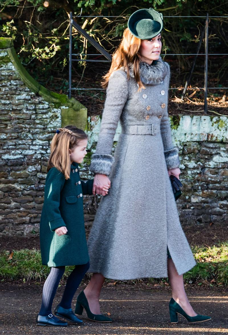For Christmas, she opted for a custom Catherine Walker coat and aLock & Co. fascinator.