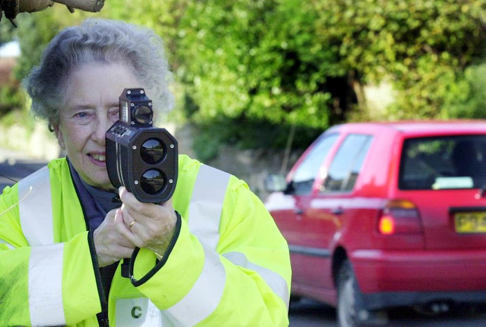 An archive photo shows a volunteer in Ash, Somerset, with a speed gun.  (PA)