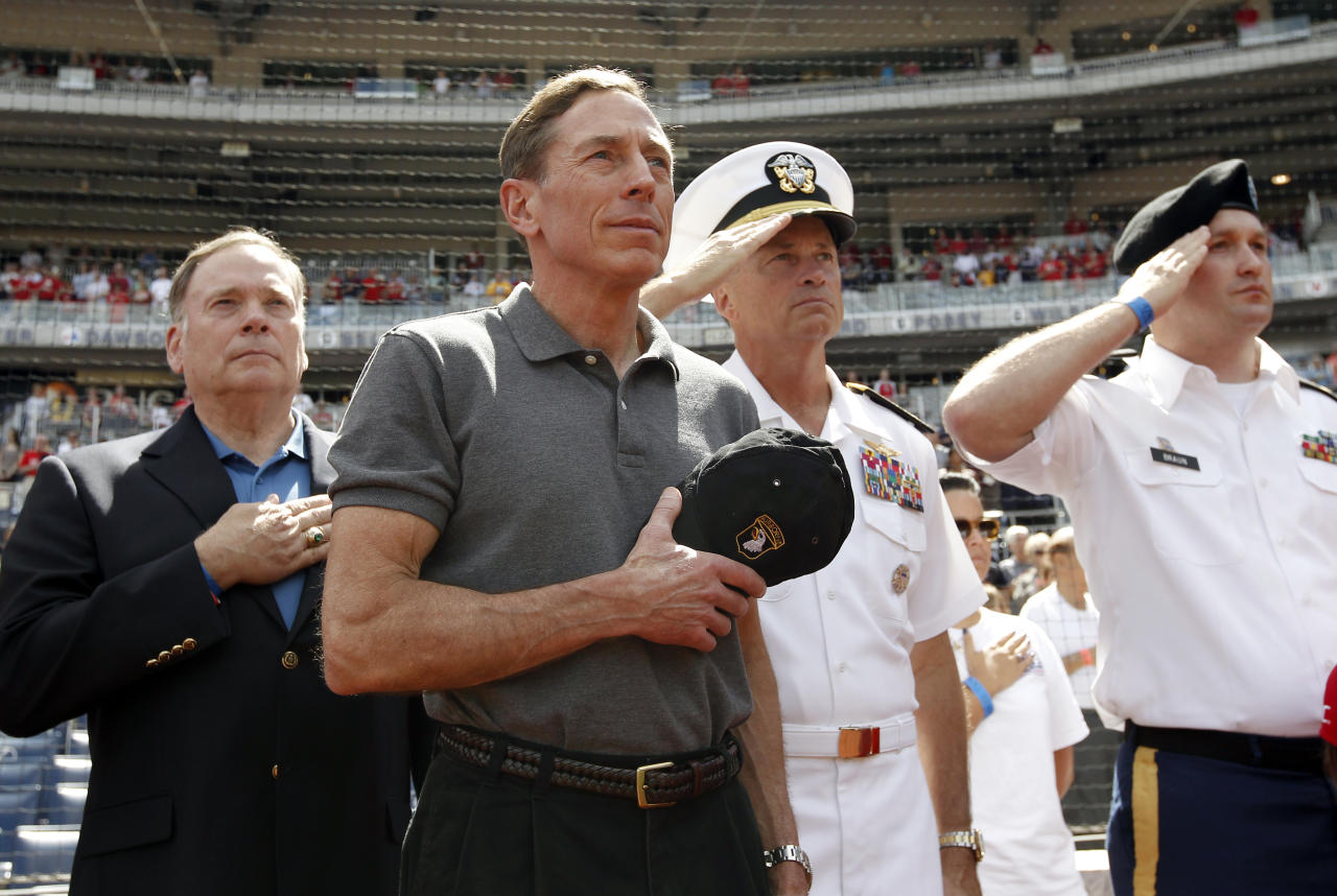 CIA Director David Petraeus, second from left, stands with Admiral James A. ìSandyî Winnefeld, Vice Chairman of the Joint Chiefs of Staff, second from right, before a baseball game between the Washington Nationals and the Miami Marlins at Nationals Park Sunday, Sept. 9, 2012, in Washington. (AP Photo/Alex Brandon)