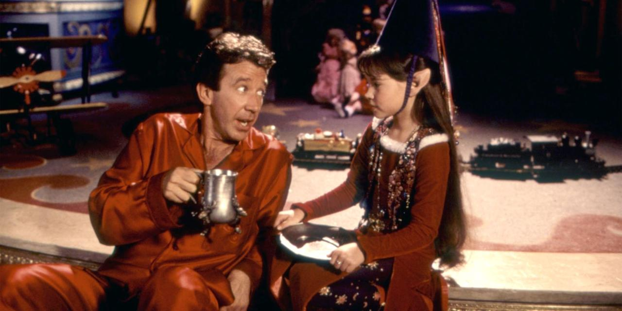 "<p>The official unofficial king of Christmas, Tim Allen, dons the big man's belly to play Scott Calvin, a workaholic toy salesman who's about to take his work to the North Pole. After Santa falls off his roof one Christmas Eve, Scott is magically tasked with the man in red's seasonal duties, and thus the adventure—and cookie binging—begins.  <a class=""body-btn-link"" href=""https://www.amazon.com/Santa-Clause-Tim-Allen/dp/B00D6098R2?tag=syn-yahoo-20&ascsubtag=%5Bartid%7C10056.g.13152053%5Bsrc%7Cyahoo-us"" target=""_blank"">Watch Now</a><br></p>"