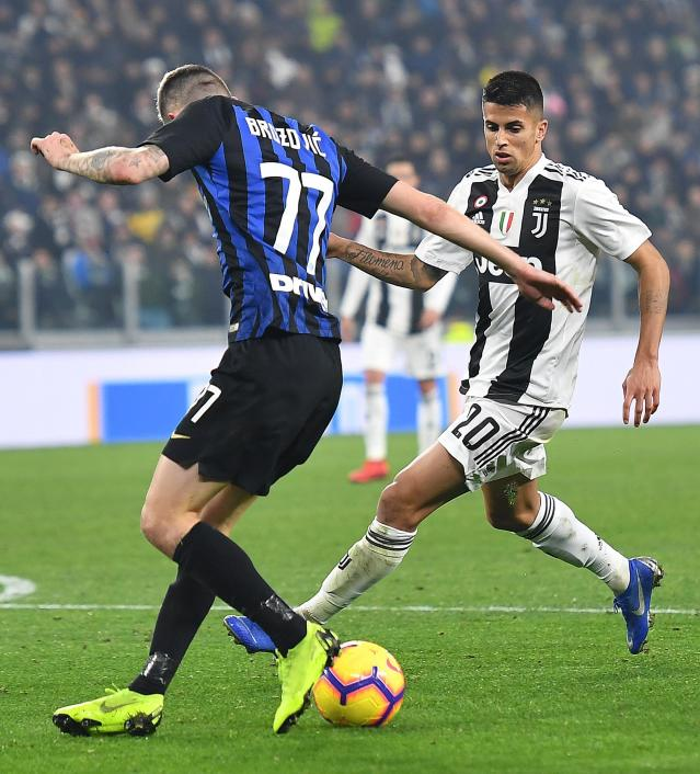 Juventus' Joao Cancelo, right, challenges Inter's Marcelo Brozovic during the Serie A soccer match between Juventus and Inter Milan at the Turin Allianz stadium, Italy, Friday, Dec. 7, 2018. (Alessandro Di Marco/ANSA via AP)