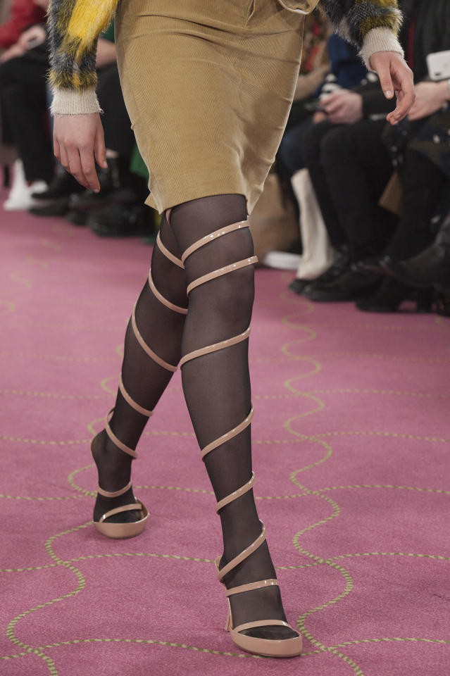 <p>Pink heels that coil up to your thighs debuted at the Y/Project FW18 show during Paris Fashion Week. (Photo: Getty) </p>