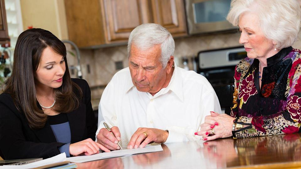 A business woman working with her senior citizen clients.