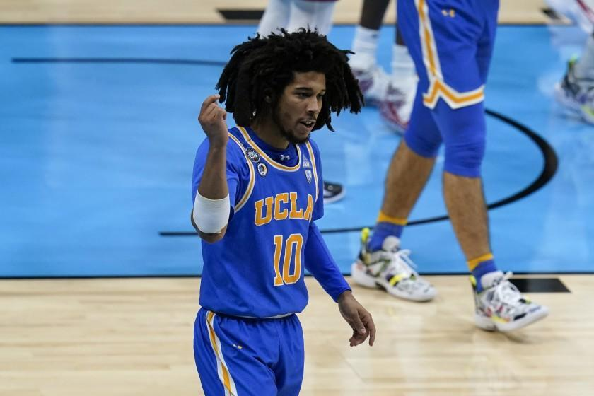 UCLA guard Tyger Campbell (10) celebrates after making a basket during the first half of a men's Final Four NCAA college basketball tournament semifinal game against Gonzaga, Saturday, April 3, 2021, at Lucas Oil Stadium in Indianapolis. (AP Photo/Michael Conroy)