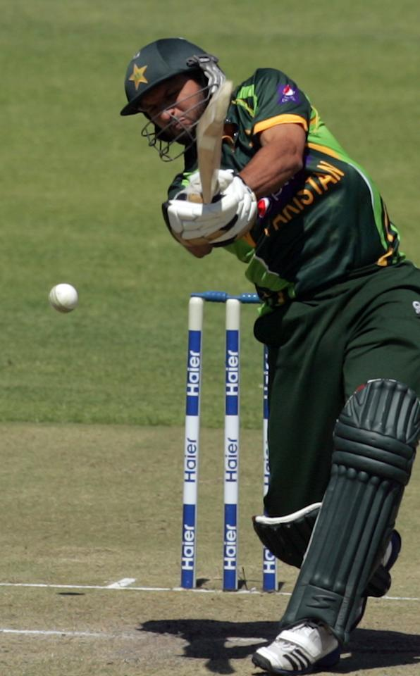 Pakistan batsman Shahid Afridi in action during the first game of the three match ODI cricket series between Pakistan and Zimbabwe at the Harare Sports Club on August 27, 2013. AFP PHOTO / JEKESAI NJIKIZANA        (Photo credit should read JEKESAI NJIKIZANA/AFP/Getty Images)