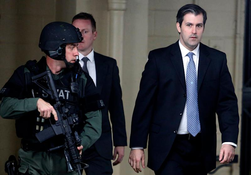 South Carolina police officer Michael Slager, right, walks from the Charleston County Courthouse - Mic Smith/AP
