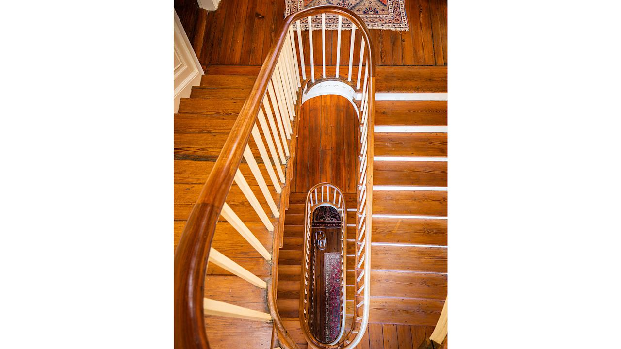 <p>The home's original staircase spirals up throughout all four floors.</p>
