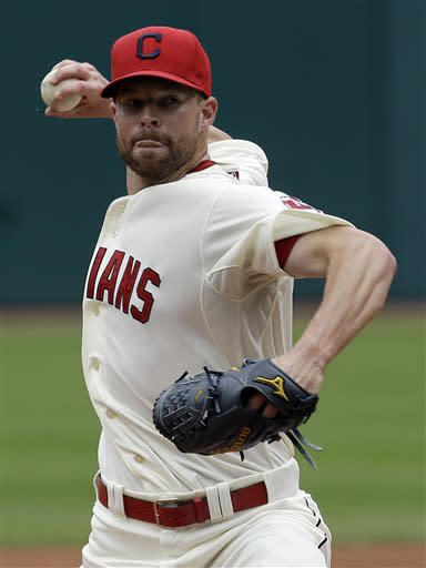 Cleveland Indians starting pitcher Corey Kluber delivers a pitch in the first inning of a baseball game against the Detroit Tigers, Sunday, July 7, 2013, in Cleveland. (AP Photo/Tony Dejak)