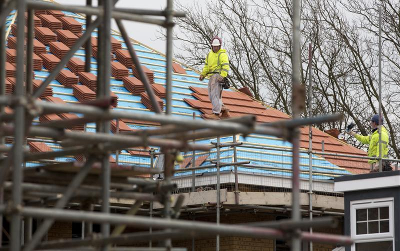 Construction workers build a new residential property development in north London