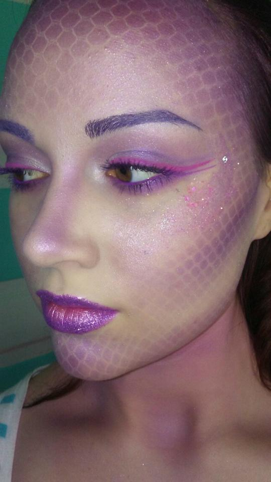 "The first rule of mermaid makeup: Don't forget the scales. ""I use a mesh wig cap over my face and a dense stippling brush to layer three different <a href=""https://www.sephora.com/product/obsessions-gemstone-eyeshadow-palette-P45188659"" rel=""nofollow"">purple eye shadow shades</a>,"" says makeup artist Yasmine Violet (<a href=""https://www.instagram.com/lifeiswhatyoucakeit/"" rel=""nofollow"">@lifeiswhatyoucakeit</a>). Concentrate the color at your contour and along your hairline, remove the mesh, then add to lids for a mesmerizing monochromatic face."