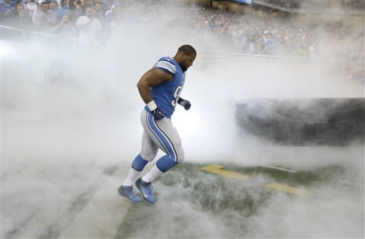 Detroit Lions defensive tackle Ndamukong Suh runs onto the field during player introductions before an NFL football game against the Minnesota Vikings at Ford Field in Detroit, Sunday, Sept. 30, 2012. (AP Photo/Carlos Osorio)