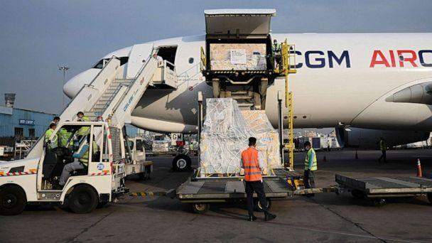 PHOTO: Ground staff unload the COVID-19 coronavirus medical supplies from France, upon the arrival of a cargo plane at the Indira Gandhi International Airport in New Delhi on May 2, 2021. (Money Sharma/AFP via Getty Images)
