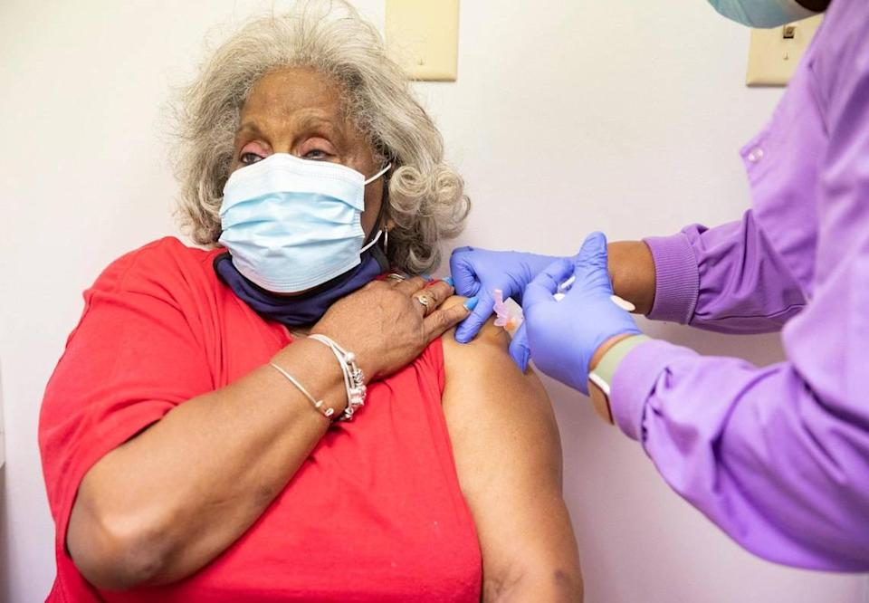 Shirley Kemp of New Beginning Missionary Baptist Church receives her vaccination shot on Friday, January 22, 2021. Jackson Health System has partnered with nearly 55 churches, synagogues and mosques in Miami-Dade County with the goal of reaching people who are age 65 and older in underserved communities.