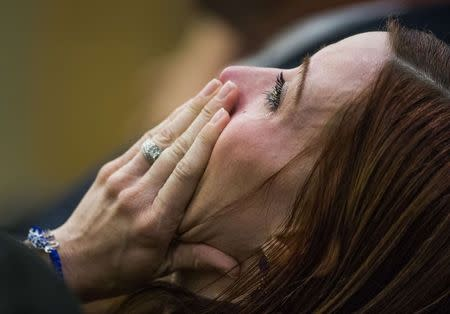 Tanisha Sovenson, sister of Travis Alexander, sobs as she hears a hung jury verdict in the Jodi Arias sentencing phase retrial, in Phoenix March 5, 2015.  REUTERS/Tom Tingle/Pool