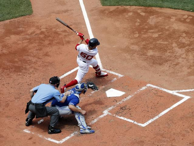 Boston Red Sox's Mookie Betts follows through on a hit against the Toronto Blue Jays during the first inning of a baseball game Saturday, July 14, 2018, in Boston. (AP Photo/Winslow Townson)