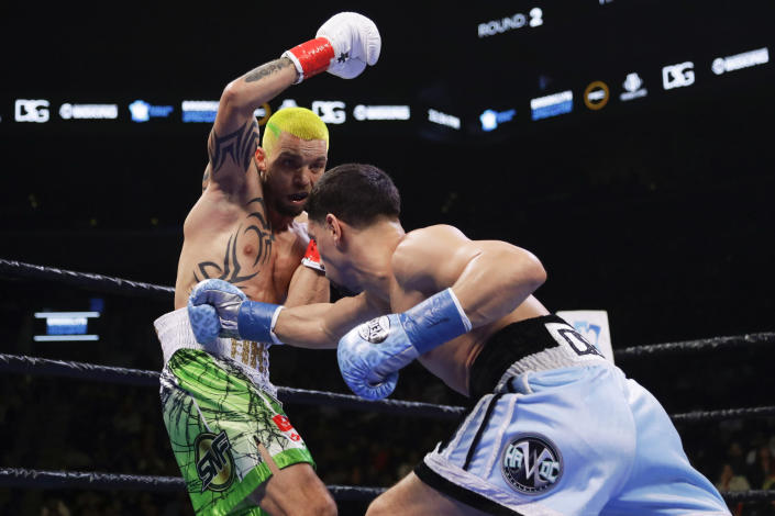 Ukraine's Ivan Redkach, left, evades Danny Garcia during the second round of a welterweight boxing match Saturday, Jan. 25, 2020, in New York. Fulton won the fight. Hurd won the fight. (AP Photo/Frank Franklin II)