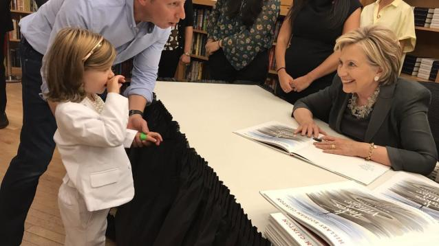 A little girl named Grace wore her own version of Hillary Clinton's signature outfit to meet her idol at a book signing in Brooklyn and the photos are just too damn cute.