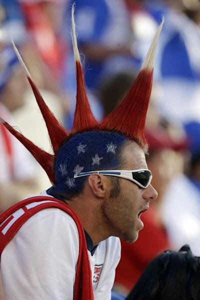 A United States fan cheers in the first half during a World Cup qualifying soccer match against Honduras at Rio Tinto Stadium on Tuesday, June 18, 2013, in Sandy, Utah. (AP Photo/Rick Bowmer)