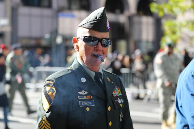 <p>A veteran enjoys a cigar as he marches up Fifth Avenue during the Veterans Day parade in New York City on Nov. 11, 2017. (Photo: Gordon Donovan/Yahoo News) </p>