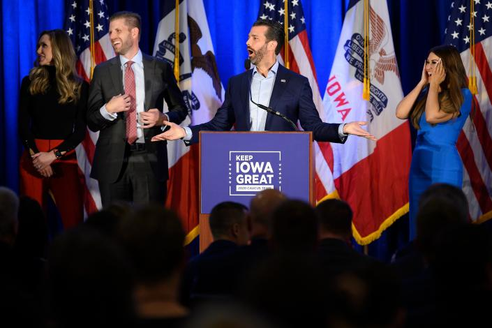 "Donald Trump Jr., center, speaks with his brother Eric, second from left, during a ""Keep Iowa Great"" press conference in Des Moines on Monday. (Jim Watson/AFP via Getty Images)"