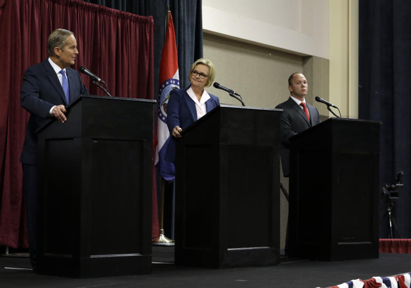 Republican Rep. Todd Akin, left, speaks as Democratic Sen. Claire McCaskill, center, and Libertarian Jonathan Dine listen during the first debate in the Missouri Senate race Friday, Sept. 21, 2012, in Columbia, Mo. (AP Photo/Jeff Roberson)