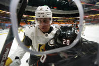 Vegas Golden Knights defenseman Zach Whitecloud, left, pushes Anaheim Ducks left wing Nicolas Deslauriers into the boards during the second period of an NHL hockey game Saturday, Feb. 27, 2021, in Anaheim, Calif. (AP Photo/Mark J. Terrill)