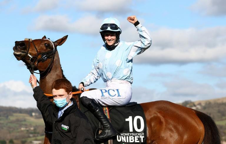 Jockey Rachael Blackmore celebrates her victory on Honeysuckle in the Champion Hurdle at Cheltenham
