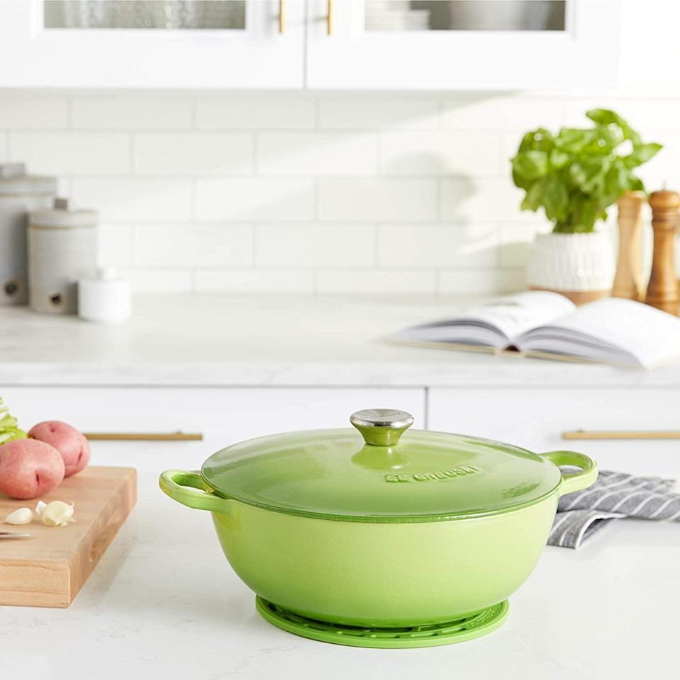 <p><span>Le Creuset Enameled Cast Iron Curved Round Chef's Oven with Silicone French Trivet</span> ($180, originally $316)</p>
