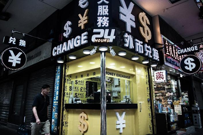 World equities and high-yielding currencies have soared since the Bank of Japan said it would target boosting inflation and the Federal Reserve pressed on with policies that makes cash cheap (AFP Photo/Philippe Lopez)