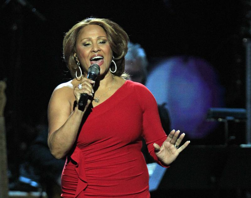 FILE - This April 14, 2012 file photo shows Darlene Love performing at the 2012 Rock and Roll Hall of Fame induction in Cleveland. Love is recovering from a mild heart attack, her agent said Friday, July 27. Eric Stevens said on the phone that the 71-year-old singer-actress experienced some discomfort prior to a performance over the weekend in Asbury Park, N.J. As the pain grew a day later, Love went to a hospital and was told she suffered a mild heart attack. (AP Photo/Tony Dejak, file)