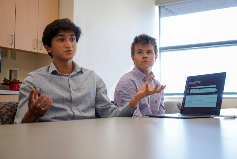 Rohan Kanchana, 16, left, a junior at Newark Charter School, talks about how he used his coding skills to creator the computer program DECODR as Ben Dupont, 17, a senior at Tower Hill, listens.