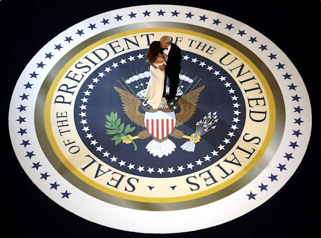 <p>President Donald Trump and his wife First Lady Melania Trump kiss and dance on stage during A Salute To Our Armed Services Inaugural Ball at the National Building Museum on January 20, 2017 in Washington, D.C. (Alex Wong/Getty Images) </p>