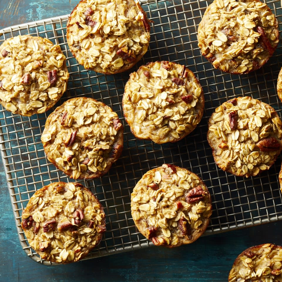 """<p>Muffins meet oatmeal in these moist and tasty grab-and-go oatmeal cups. Feel free to swap out the pecans for any other nut--walnuts would be great--or omit them altogether. Make a batch on the weekend and keep them in your fridge or freezer for quick and easy breakfasts all week. Reheat in the microwave for about 40 seconds. <a href=""""http://www.eatingwell.com/recipe/274166/baked-banana-nut-oatmeal-cups/"""" rel=""""nofollow noopener"""" target=""""_blank"""" data-ylk=""""slk:View recipe"""" class=""""link rapid-noclick-resp""""> View recipe </a></p>"""