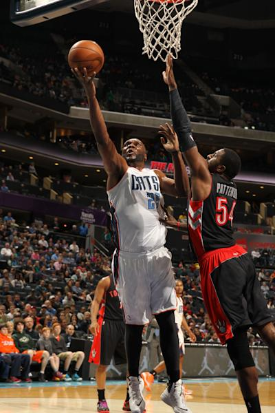 CHARLOTTE, NC - JANUARY 20: Al Jefferson #25 of the Charlotte Bobcats shoots against Patrick Patterson #54 of the Toronto Raptors during the game at the Time Warner Cable Arena on January 20, 2014 in Charlotte, North Carolina. (Photo by Kent Smith/NBAE via Getty Images)