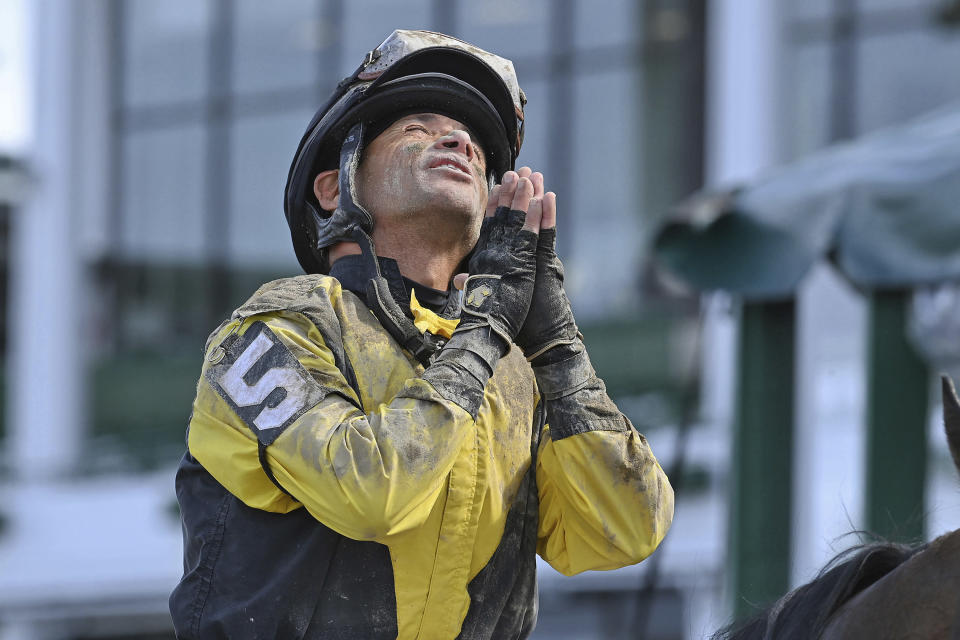 This photo provided by Equi-Photo shows jockey Jose Ferrer gesturing after winning the Salvatore Mile aboard Informative at Monmouth Park Racetrack in Oceanport, N.J., Saturday June 12, 2021. Ferrer, 57, is leading all jockeys in wins at Monmouth Park in New Jersey after 10 days of racing with 16 wins in 56 mounts. (Joe Labozxetta/Equi-Photo via AP)