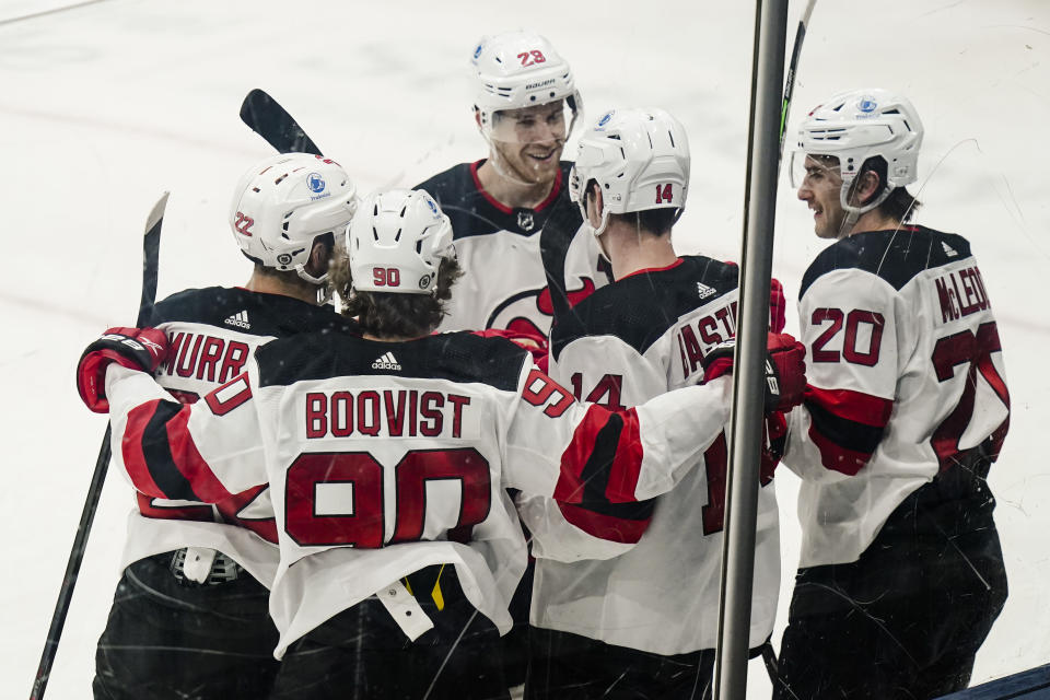 New Jersey Devils' Michael McLeod (20) celebrates with teammates after scoring a goal during the second period of the team's NHL hockey game against the New York Islanders on Thursday, May 6, 2021, in Uniondale, N.Y. (AP Photo/Frank Franklin II)