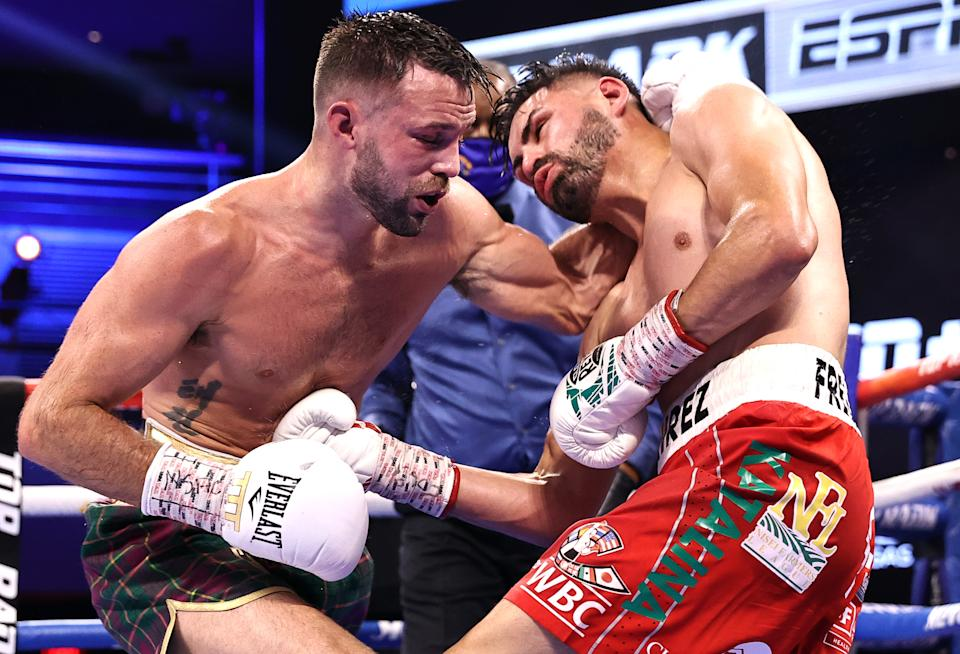 LAS VEGAS, NEVADA - MAY 22: Josh Taylor(L) and Jose Ramirez(R) exchange punches during their fight for the Undisputed junior welterweight championship at Virgin Hotels Las Vegas on May 22, 2021 in Las Vegas, Nevada. (Photo by Mikey Williams/Top Rank Inc via Getty Images)
