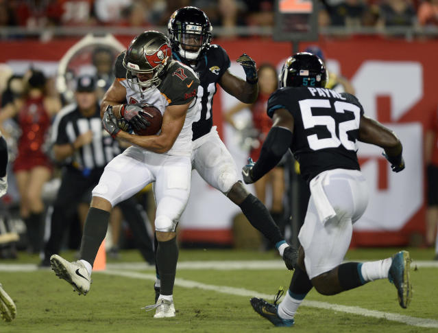 Tampa Bay Buccaneers wide receiver Justin Watson (17) pulls in a two-yard touchdown reception in front of Jacksonville Jaguars cornerback Jalen Myrick (31) and linebacker Donald Payne (52) during the first half of an NFL preseason football game Thursday, Aug. 30, 2018, in Tampa, Fla. (AP Photo/Jason Behnken)